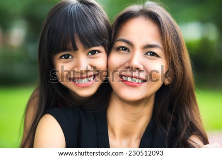 Happy mother and child girl, Outdoor