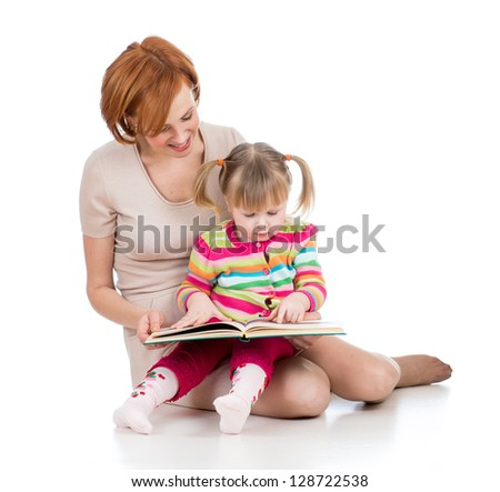 happy mother and child reading a book together - stock photo