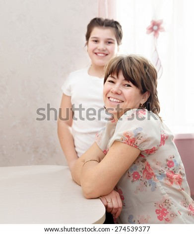 Happy mother and daughter  at home