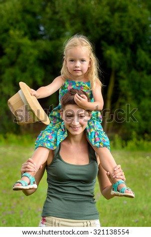 Happy mother and daughter having fun together, family time concept - stock photo