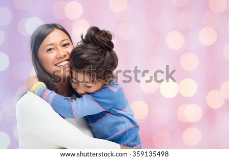 happy mother and daughter hugging - stock photo