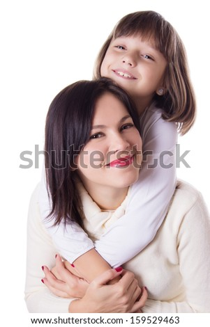 Happy mother and daughter hugging isolated on white