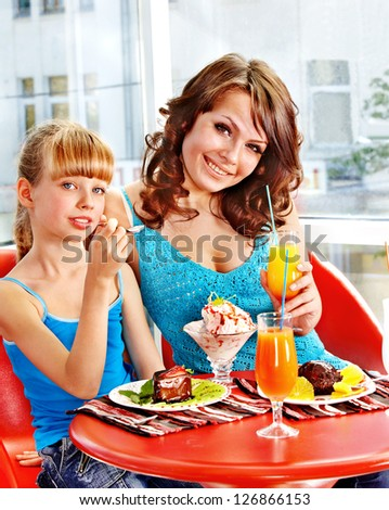 Happy mother and daughter in restaurant.
