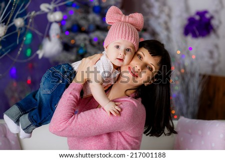 happy mother and daughter near a Christmas tree. Christmas - stock photo
