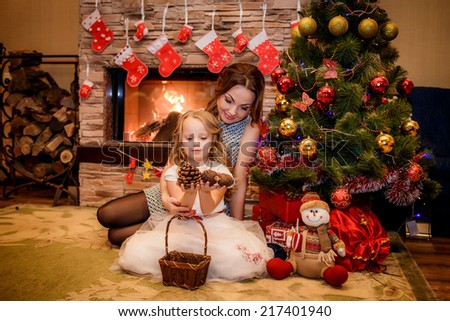 happy mother and daughter near a Christmas tree. Christmas holidays. Christmas decor. new year - stock photo
