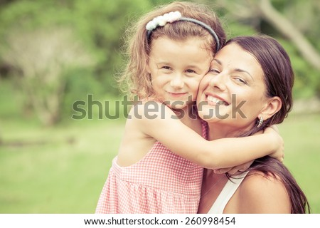 Happy mother and daughter playing in the park at the day time. Concept of celebration Mothers day .