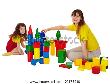 Happy mother and daughter playing with blocks isolated on white - stock photo