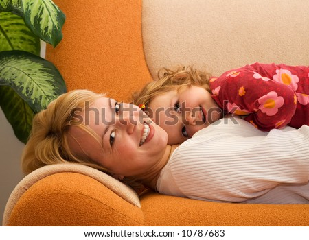 Happy mother and daughter sharing a tender moment - stock photo