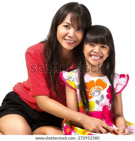 Happy mother and daughter sitting, Isolated over white - stock photo