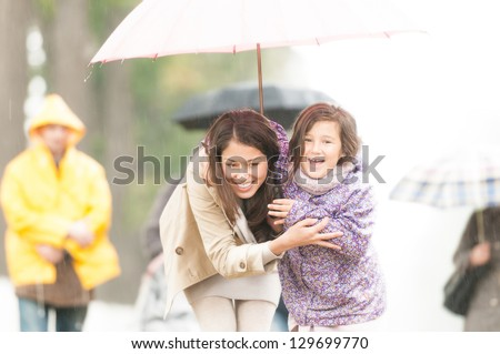 stock-photo-happy-mother-and-daughter-walking-in-park-smiling-parent-and-kid-hiding-under-umbrella-laughing-129699770 Why Is Dating A Polish Young lady So Eye-catching?