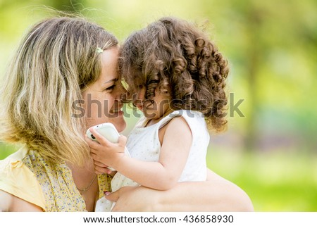 Happy mother and daughter with embracing, close up portrait. Instagram filter. - stock photo
