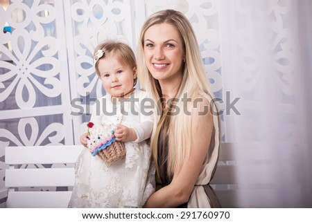 Happy mother and daughter with toy - stock photo