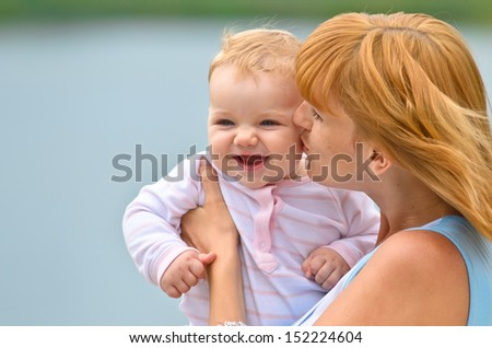 happy mother and her baby in nature