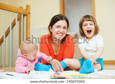 Happy mother and her children an home - stock photo