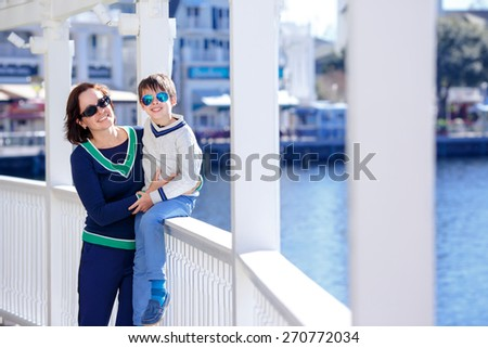 Happy mother and her cute little son outdoors during his summer vacation - stock photo