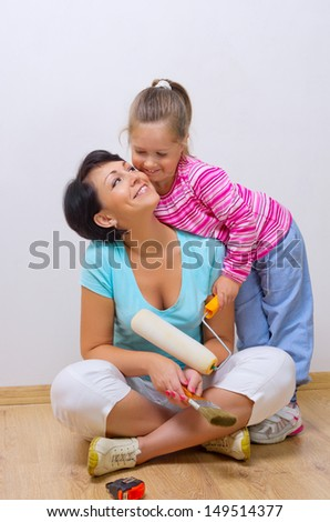 Happy mother and her daughter with repairing tools