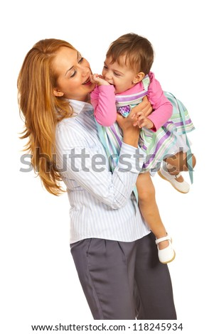 Happy mother and her little daughter having fun isolated on white background - stock photo