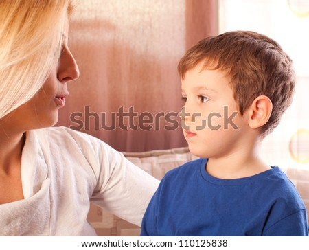 Happy mother and her son drawing together. - stock photo