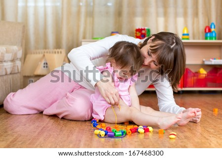 happy mother and kid play together