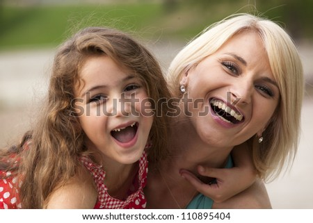 happy Mother and smiling baby - stock photo