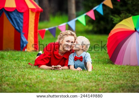 Happy mother and son in a park - stock photo
