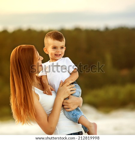 happy mother and son in the mountains playing