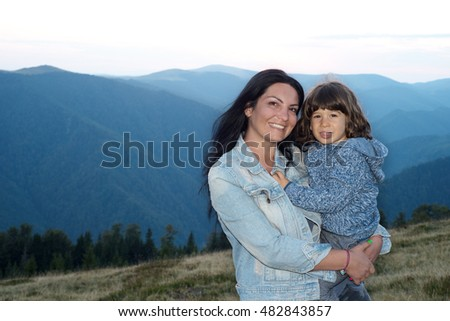 Happy mother and son in the mountains  posing