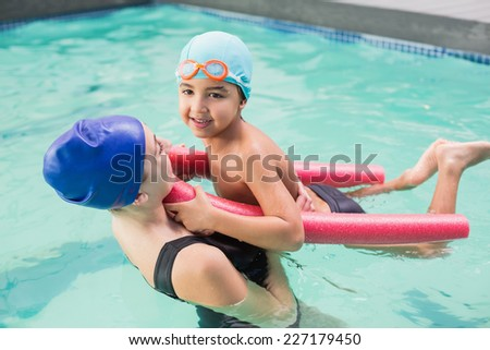 Happy mother and son in the swimming pool at the leisure center - stock photo