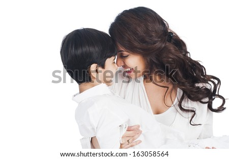 Happy mother and son nuzzling - stock photo