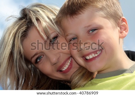 Happy mother and son smiling closeup