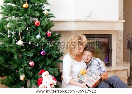 happy mother and son with christmas presents