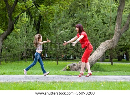 Happy mother and the daughter run towards each other