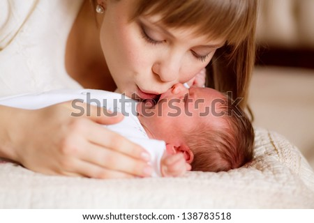 happy mother breast feeding her baby infant