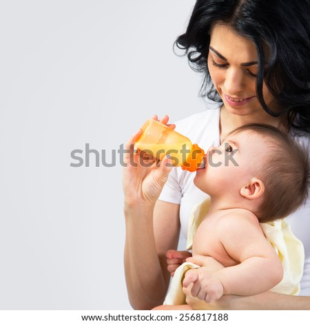 Happy mother breastfeeding her baby - stock photo