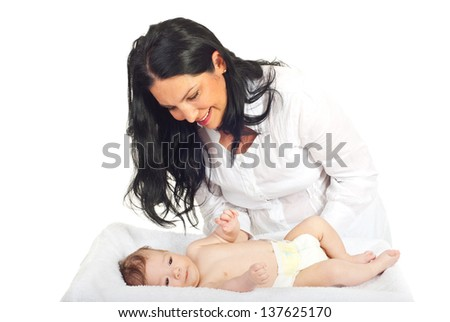 Happy mother caring her newborn baby boy isolated on white background