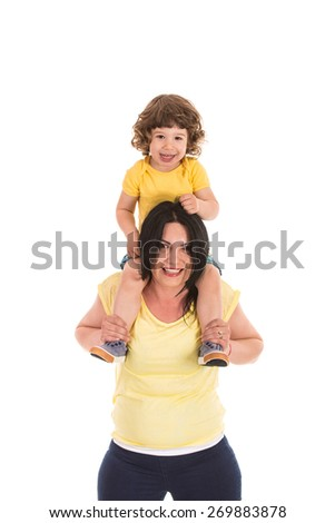 Happy mother carrying toddler boy on her shoulder and having fun together isolated on white background - stock photo