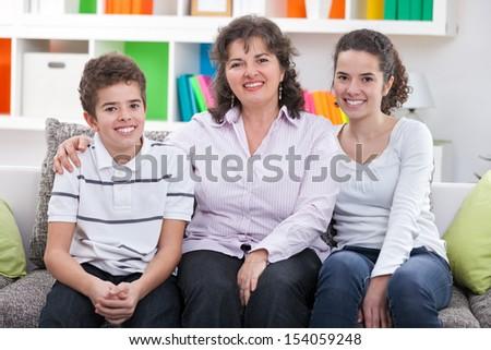 happy mother  embracing her children - stock photo