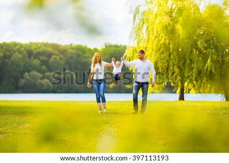 happy mother,father and son on a walk on a Sunny day