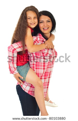 Happy mother giving piggy back ride to her daughter isolated on white background - stock photo