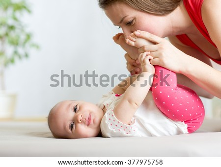 happy mother having fun with her baby infant - stock photo