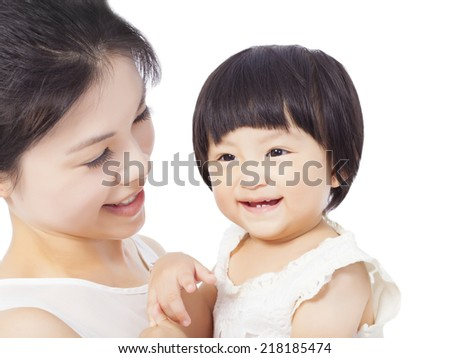 Happy mother holding adorable child baby boy - stock photo