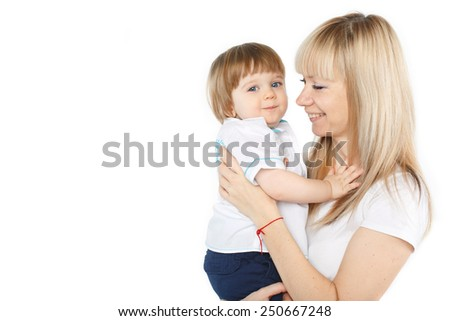 happy mother holding and looking with love at her happy cute baby boy over white background - stock photo