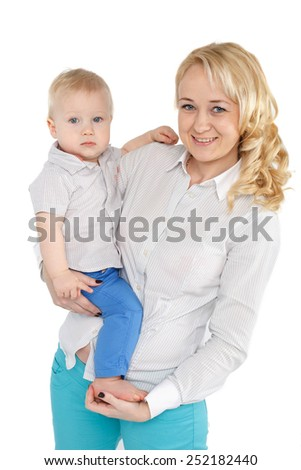 happy mother holding blonde blue eyed boy on her hands over white background - stock photo
