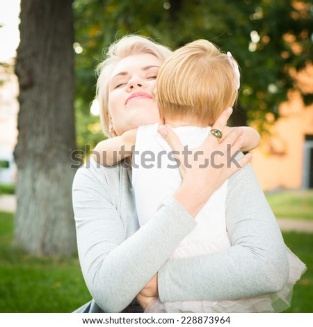 happy mother holding her 2 years old child
