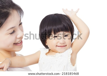 Happy mother holding smiling child baby over white background - stock photo