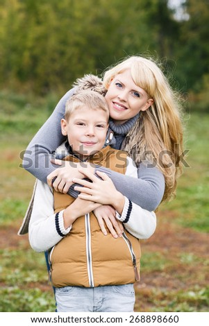 Happy mother hugging her little son. Family idyll concept