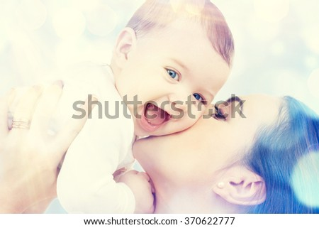 happy mother kissing baby