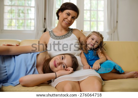 Happy mother of two lovely sisters, focus on teenage girl - stock photo
