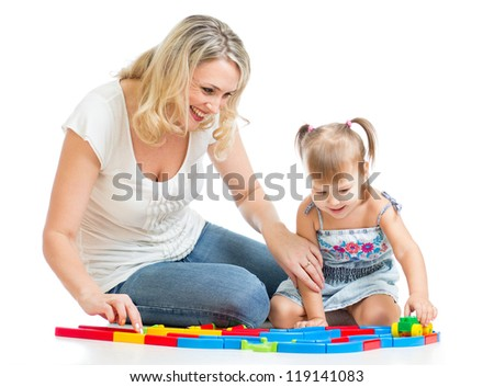 happy mother playing with kid girl