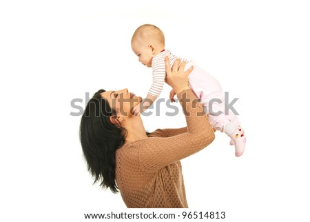 Happy mother raising her baby daughter and talking with her isolated on white background